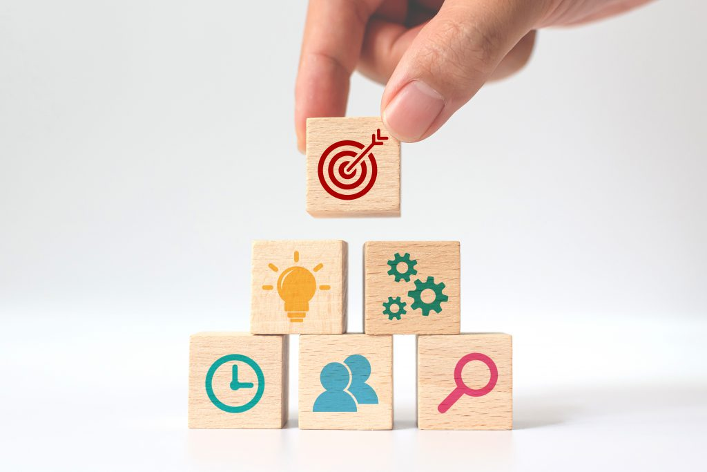 concept business strategy action plan hand putting wooden cube block stacking with icon scaled