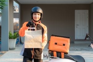 delivery asian man wearing orange uniform ready send delivering food bag front customer houes with food case box scooter express food delivery shopping online concept