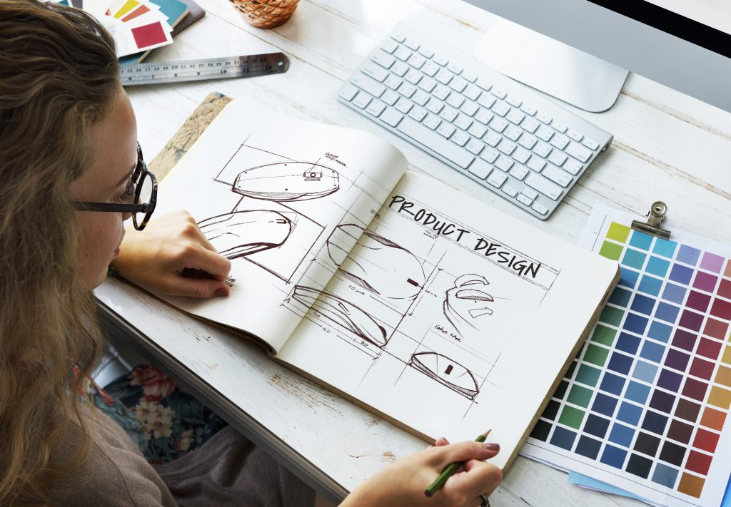 designer with sketch book scaled