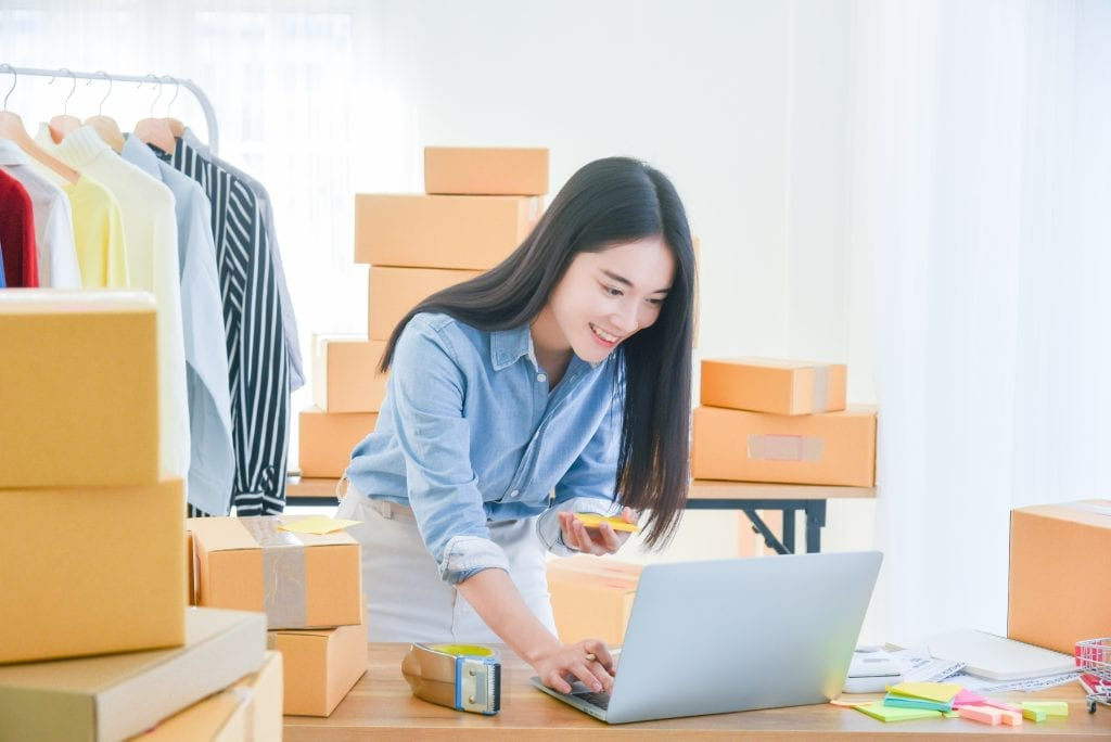 female startup small business owner working with notebook computer office