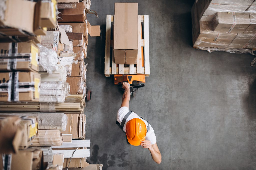 young man working warehouse with boxes